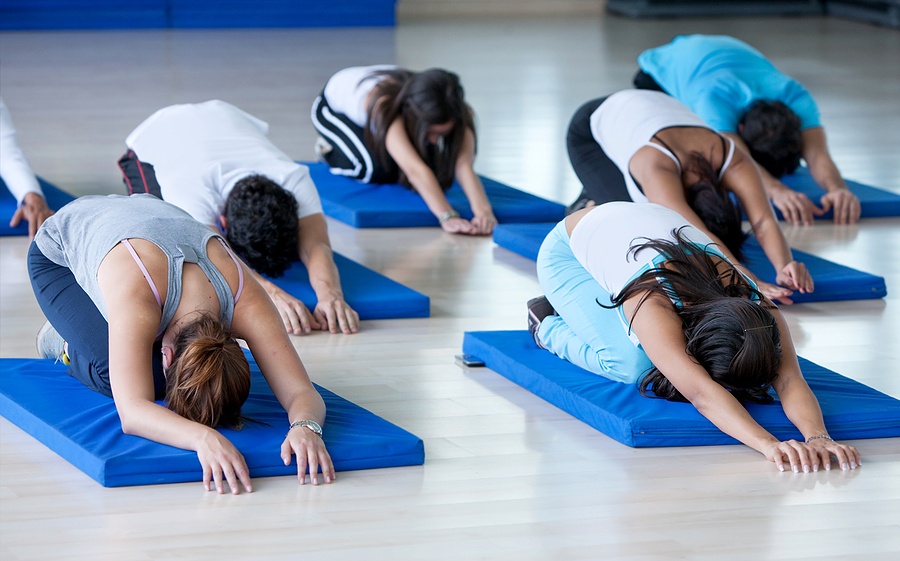 a group of people taking part in a pilates class